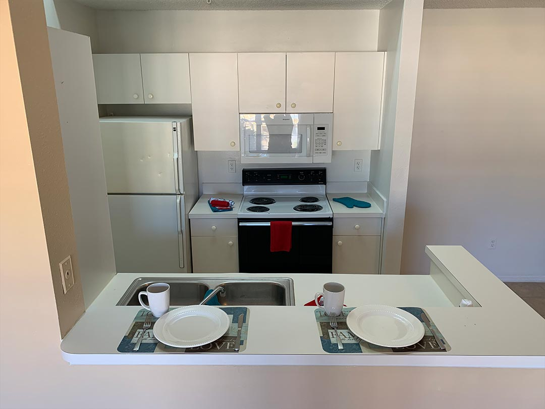 Photo Of A Functional Apartment Kitchen.
